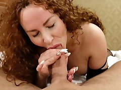 Red-haired accomplished deepthroats a huge hard-on and splashes wink