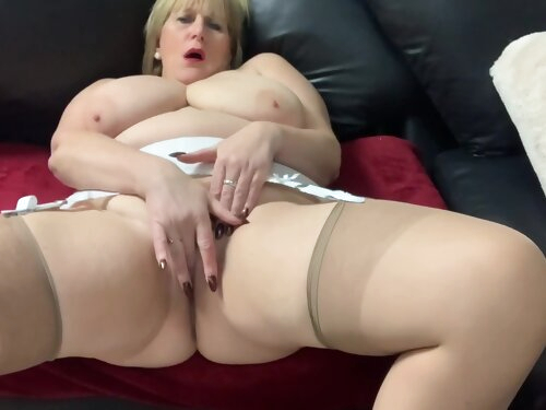 Mature Catherine Plays With Her Big Boobs And Thumbs Herself To Climax