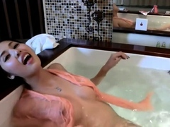 Chinese D/s taking a tub with a webcam.