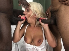 Mother gets screwed by 2 dark-hued studs in the same time